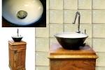 Handfat i stengods som tillsammans med det gamla pottskåpet blivit ett unikt tvättställ. Glasyren är blank vit  och blank svart.